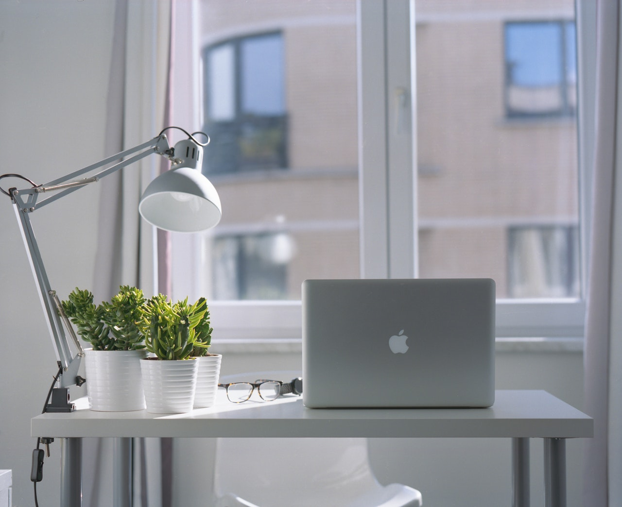 silver macbook air and goose neck lamp 939331 | Sparrow Websites