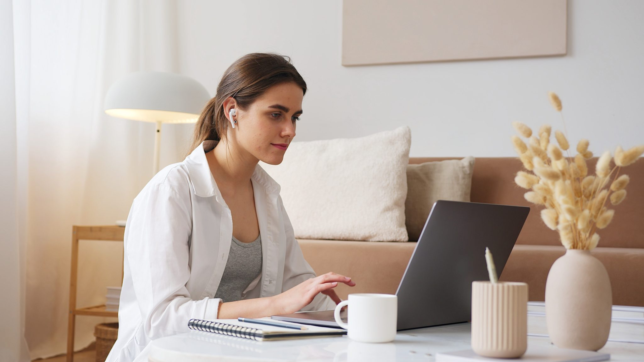 thoughtful woman with earbuds using laptop 4492161 scaled | Sparrow Websites